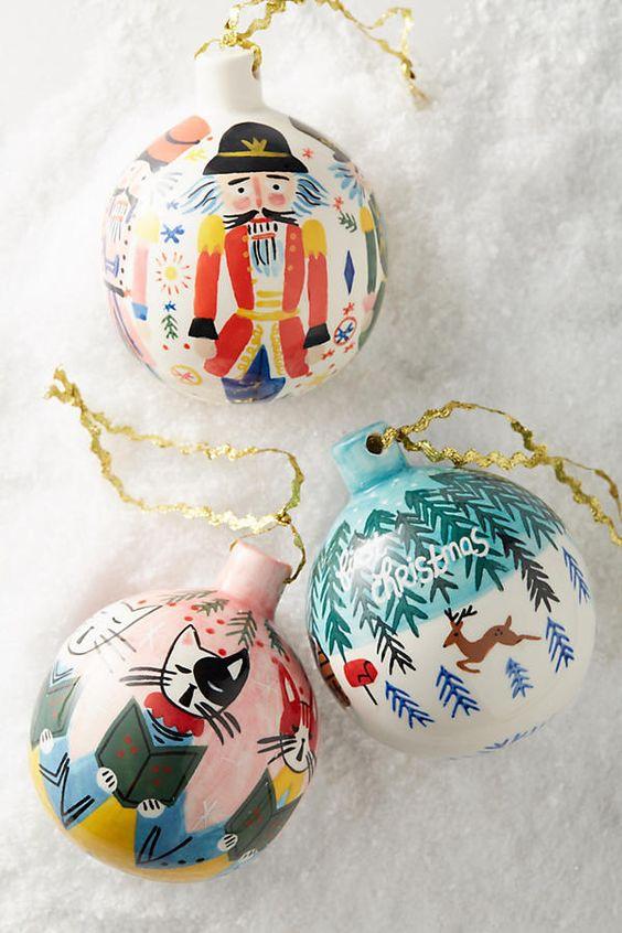 DIY glass ball ornaments; Christmas tree ornaments; handmade presents; Christmas balls; hand painted Christmas ornaments; Christmas ball ornament ideas; DIY snow globe ornaments.